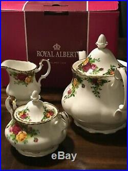 Royal Albert Old Country Roses 1teapot. 1sugar. 1creamer 4 Cups. 4 Saucers. 1plate